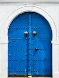 Blue gate and door with ornament from Sidi Bou Said. In Tunisia Stock Image