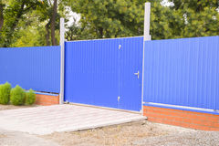Blue gate and fence Royalty Free Stock Photography