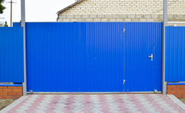 Blue gate and fence Royalty Free Stock Image