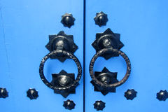 Blue gate with round handles Royalty Free Stock Photo