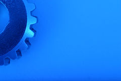 Blue Gear 6. Gear wheel in upper corner of blue image Royalty Free Stock Photography