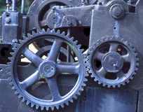 Blue Gears. Old steam engine with blue gears stock images