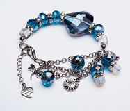 Blue gem bracelet with pendants Royalty Free Stock Photos