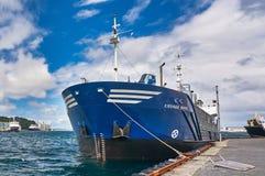 Blue general cargo ship Stock Photo