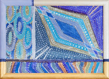 Blue geometric pattern in painted wooden frame Royalty Free Stock Photo