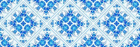 Blue geometrical seamless pattern with painted floral elements in ceramic tiles style.  royalty free illustration