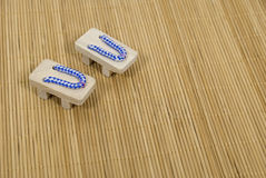Blue Geta Sandals on Grass Mat Stock Photos