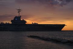 Blue ghost. USS Lexington aircraft carrie is silhouetted against morning sunrise Royalty Free Stock Photography