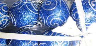 Blue gift 18. Christmas box with silver shine ornaments stock photo