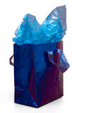 Blue Gift Bag. Shiny blue gift bag with blue tissue paper Royalty Free Stock Photography
