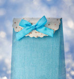 Blue gift bag with bow. On snow background Stock Images