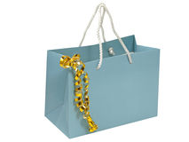 Blue gift bag with golden decorative tape. Royalty Free Stock Image