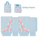 Blue gift bag with stripes and pink flowers Stock Image