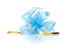 Blue gift bow with a gold ribbon isolated on white background wi Stock Image