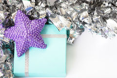 Blue gift box. Pretty blue gift box with purple star on top stock photos