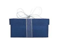 Blue gift box. With a ribbon isolated on white Stock Images