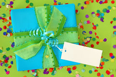 Blue gift box. On green background stock photography