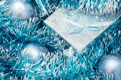 Blue gift box. And ornaments Stock Photography