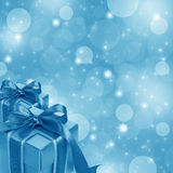 Blue gift box on abstract blue background Royalty Free Stock Image