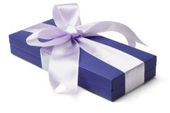 Blue gift box with big bow ribbon Royalty Free Stock Photography
