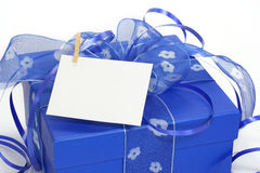 Blue gift box with a blank not. E isolated on white background royalty free stock images