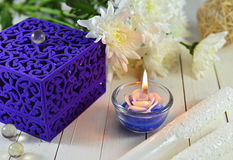 Blue gift box with blue candle Stock Image