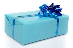 Blue gift box with a bow and a blue ribbon Stock Images