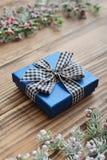 Blue gift box with checkered ribbon Stock Photo