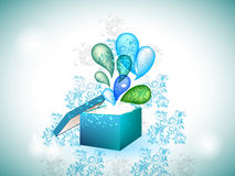 Blue gift box with exploding swirls. Stock Images