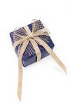 Blue gift box with gold ribbon Stock Images