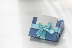 Blue gift box on gray wooden texture background with blank namec Stock Photography
