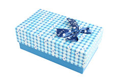 Blue gift box with a lid isolated. Blue gift box with a lid isolated on white background Royalty Free Stock Image