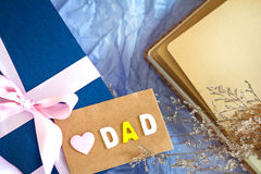 blue gift box with pink ribbon decoration and Love Dad message on polka blue paper , Happy Father`s Day concept , top view an Royalty Free Stock Images