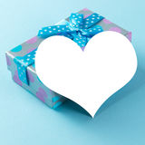 Blue gift box with plain card Stock Images