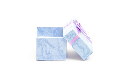 Blue gift box with purple ribbon leaning against another Stock Photography