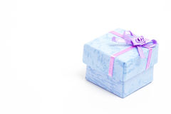 Blue gift box with purple ribbon Royalty Free Stock Photo