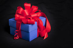Blue gift box with red ribbon and bow Royalty Free Stock Photography
