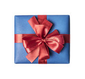 Blue gift box with red ribbon bow Stock Image
