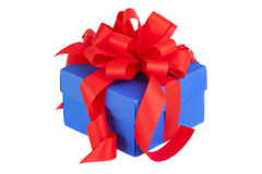 Blue gift box with red ribbon and bow. Isolated on white royalty free stock photography