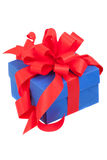Blue gift box with red ribbon and bow Stock Photography