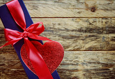 Blue gift box with red ribbon and heart Royalty Free Stock Image