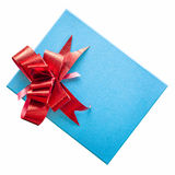 Blue gift box with red ribbon on isolated white. Royalty Free Stock Photo
