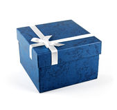 Blue gift box with ribbon bow  on white Royalty Free Stock Images