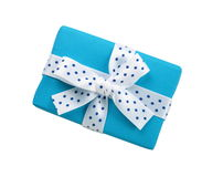 Blue gift box with ribbon bow. Wrapped blue gift box with ribbon bow, isolated on white stock photo
