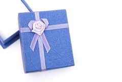 Blue gift box with ribbon and flower Stock Image