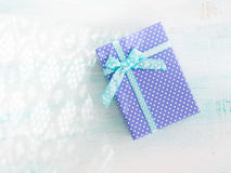 Blue gift box with ribbon pastel background. Fathers day Royalty Free Stock Image