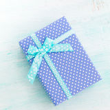Blue gift box with ribbon pastel background. Fathers day Royalty Free Stock Photos