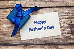 Blue gift box with ribbons and space for text on wooden table. Father`s Day Concept stock photo
