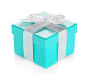 Blue gift box with silver ribbon and bow Stock Images