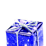 Blue  gift box with silver ribbon, bow and snowflakes  isolated. On white macro. Christmas, Valentine's, Birthday gift box Stock Image